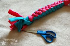 Fringe on a DIY no-sew fleece dog rope or tug toy. The tutorial is at Making It Home.