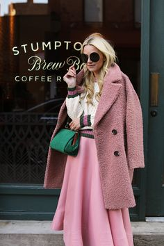 Fashion blogger Blair Eadie of Atlantic-Pacific wearing a pink Roksanda skirt, Gucci Shoes, cable sweater and Gucci logo belt in New York City.