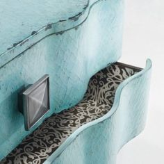 Very pretty modern crackle and drawer lining via http://www.dressers.com/chests/chests/3drawerturquoisecracklechest.cfm