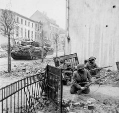 Men of 2nd Battalion, The Gordon Highlanders, supported by Churchill tanks of the 6th Guards Tank Brigade, fight their way into the town Kleve during Operation Veritable, february, 12th 1945