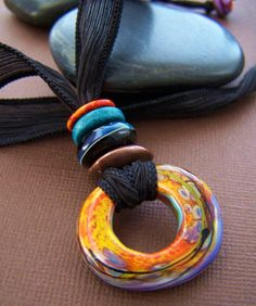 Artisan glass disc on silk ribbon. One of a kind necklace.