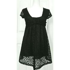 """Thick black lace baby doll styled top or tunic This isn't quite long enough to be a dress almost but would be better as a tunic. Because they tag is foreign (Asian) I'm not exactly sure what size it is. I would say it's a sm/med. It fits very loosely on me but was too small on my bust. (I'm a small with a medium bust. Pit to pit across chest laying flat is approximately 18"""" shoulder to hem is approximately 29"""". Tops Tunics"""