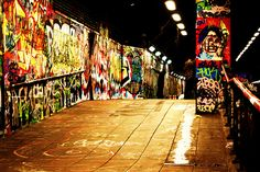 Graffiti tunnel london south bank. It's an authorized graffiti area. No sexism. No racism. No advertising. Just really cool art!