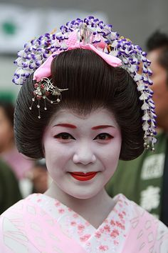 "She is a ""maiko"", not ""geisha"", typical Japanese traditional girl. Description from pinterest.com. I searched for this on bing.com/images"