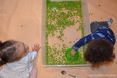 Green peas are not only fun to eat they also make a fun sensory bin filler! Here is a great taste safe sensory bin for babies, toddlers & preschoolers! Baby Sensory Play, Sensory Bins, Green Peas, Infant Activities, Toddler Preschool, Kids And Parenting, 1 Year, Happy, Ideas