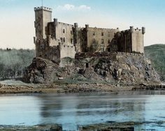Here's a late 19th century, hand-coloured photograph of Dunvegan Castle. Note the old Seagate built into the outer wall (centre of the picture); at one time this was the only entrance to the Castle. Fitted with a portcullis and drawbar, it led to a series of passageways wide enough for only one person at a time to pass through, ensuring that the guards would have the advantage in the event of an attack. The main entrance to the Castle on the landward side was created in 1748.