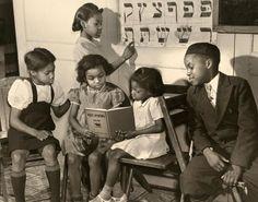 African American Jewish children studying, Harlem, 1940.