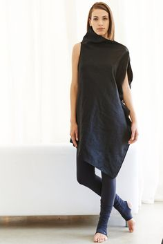 Here's to clean lines and confident women. Let us help you find your center in a lopsided world with this futuristic black linen dress that goes this