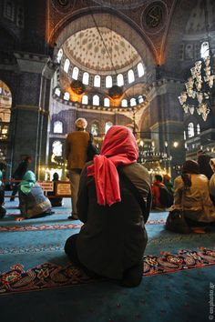 Lady with the red scarf, praying inside the Sultan Ahmed Mosque. Istanbul