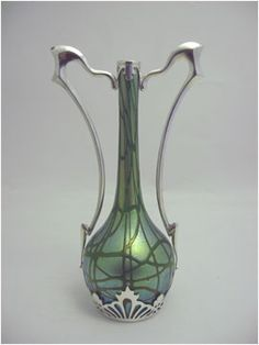 An Austrian Loetz pampas pattern vase with silvered bronze mount by Argentor c1900