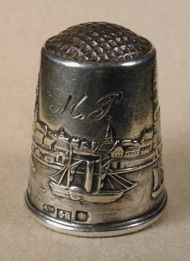 The thimble depicting Riga harbour has Latvian silver marks and an unknown maker's mark. It was made at the beginning of the 20th century and although bearing Latvian marks it may have been made in a neighbouring Scandinavian country.