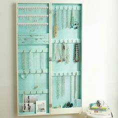Chloe Wall Mirror Jewellery Storage via PB Teen // Not a DIY, but Great Inspiration if you want to try something like this!