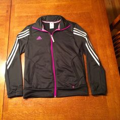 Adidas climalite jacket. Women's Adidas climalite zippered jacket.  Jacket is black with pink piping and grey/white stripes going up the arms. Size medium and in brand new condition.  100% polyester. Adidas Jackets & Coats