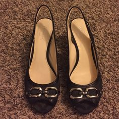 Coach Heels Beautiful black & silver Coach heels. Have been worn & need some cleaning but other than that they are in good condition. Original box not included, just the shoes.  **Final Sale** Coach Shoes Heels