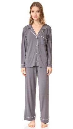 A classic Eberjey pajama set cut from super-soft jersey. The long sleeve top is detailed with notched lapels framing the button placket. Patch breast pocket and contrast piping. Matching pants with a covered elastic waistband. Pj Sets, Gisele, Pyjamas, Pajama Set, Long Sleeve Tops, Jumpsuit, Lingerie, Grey, My Style