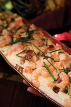 Full of spicy Louisiana flair, this dish is perfect for a more intimate get-together.  Recipe:Shrimp and Andouille Sausage With Asiago Grits