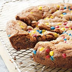 Giant Cookie-in-a-Pan - irresistible to both children and grownups alike, this super-size cookie is filled with chocolate chips and M and served in wedges. baking it in a cast-iron skillet is great way to keep the cookie perfectly round