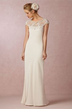 Vintage glamour meets modern beauty, this silk gown from Ranna Gill is embellished with tiny sequins and countless beads at the neckline and cap-sleeves, then gives way to an incredibly flattering bias-cut silhouette that subtly highlights your figure and a sheer, beaded back. A sophisticated choice that we love paired with sparkly heels!