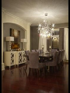 Love the sophistication. Long drapes, beautiful sideboard and chandelier.