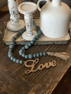 Excited to share this item from my shop: New Item! Wood Beaded Garland home decor! Farmhouse deep Turquoise with Twine tassel. Wood Bead Garland, Beaded Garland, Diy Garland, Diy Resin Crafts, Bead Crafts, Handmade Beads, Beading Tutorials, Beading Ideas, Hobbies And Crafts