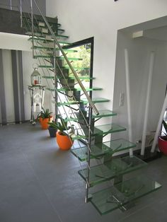 Escalera recta / peldaño de vidrio / con zanca central MANHATTAN INOX POLI & VERRE STANDARD Trescalini - Escaliers, structures et garde-corps