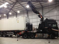 12m (40ft) super freezer, maintaining minus 60 being lifted to deliver to the site