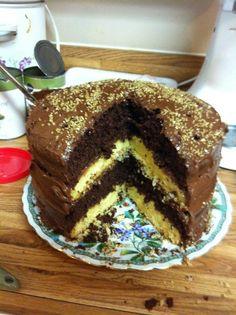 My Husband's Birthday Cake. Yellow & Chocolate Cake with Chocolate Icing. That's Gold Sugar on top.