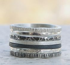 This silver rings set of 7 is made of sterling silver wire, 1,4mm width. Sterling silver bands, hammered and also black oxidized rings. Regular price for this set:80$ A discount of 15% has been made…MoreMore  #SilverJewelry