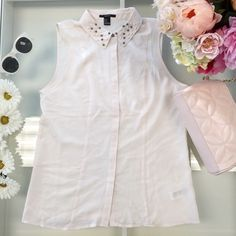 Creme sheer sleeveless top All beads are there. Worn once! Forever 21 sleeveless sheer top Forever 21 Tops Blouses