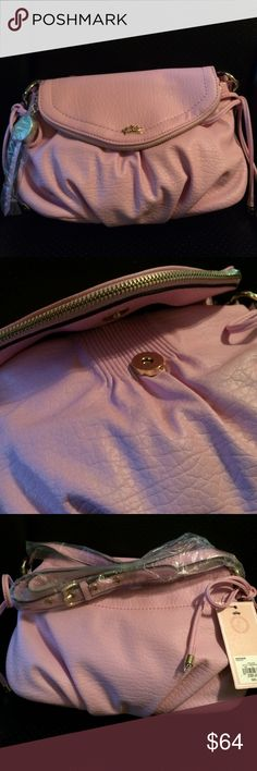 """New Juicy Couture Faux Leather Pink Bag Contemporary cross body got bed you the designer style of cuteness you deserve with the functional hands free design. 6.75 h x 10.5 w x 3.5 d. Strap drop length is 23"""" Juicy Couture Bags Crossbody Bags"""