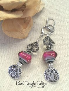 """Fushia Leaf Beaded Dangle Earrings #174 – Black Glass Leaves above a beautiful Fushia, Black, Taupe and Grey Blown Glass Bead. Dangling below are Etched Pewter Pendants. 1-1/4"""" Long."""