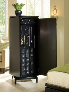 Every girl needs a nice place to house her jewelry, and a jewelry armoire is just the solution. This is a small and narrow upright chest that has room for all of your necklaces, rings and other fashion accessories. The multiple drawers and compartments make organization easy. Image courtesy of Hooker Furniture