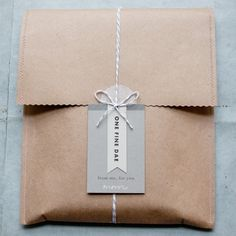 really cool and urban style of packaging, using recycle paper bag and ribbon?