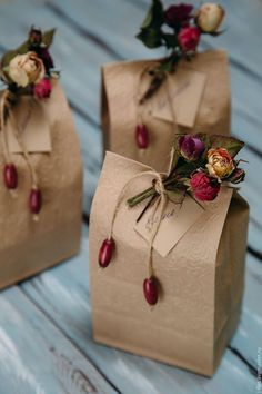 Brown paper bags with dried flowers.