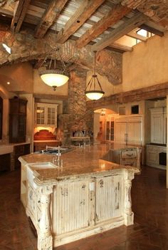 High ceilinged rustic kitchen, so much stonework....
