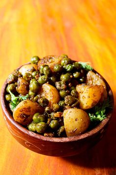 SOOKHA ALOO MATAR -- I make this often, it is a much loved & liked recipe. Best is to make this dry (sooka) curry with baby potatoes (aloo) & fresh.peas (matar). This North Indian no-onion, no-garlic recipe is mildly spiced, a bit tangy and flavorful.