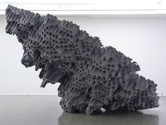 grey polystyrene bottle rack sculpture created by contemporary artist Vincent Mauger (Born in 1976 in Rennes, France).