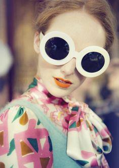8e744e091bee Colorful satin blouse with turquoise sweater vest   huge round white  sunglasses