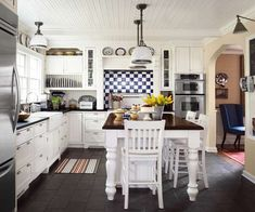 Soapstone countertops, painted pine beadboard, and a table-like island reinforce a vintage look