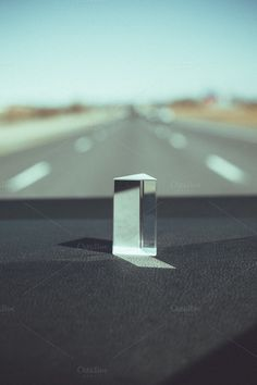 Light Prism on dashboard of car by Sean Berrigan Photography on Creative Market #light #prism #car #reflection #highway