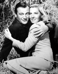 A Lady Takes a Chance (1943) - John Wayne and Jean Arthur - the scene with John Wayne in an apron with a dopey lovestruck look on his face - classic! = He starred with some awesome leading ladies. Jean Arthur one of my faves