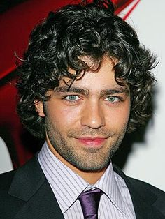 Men can also rock curly hair, as proven by Adrian Grenier.