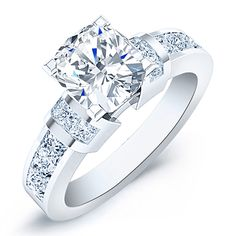 The centerpiece of this elegant engagement ring is a cushion-cut diamond with eight princess cut diamonds that are channel-set on the sides to accent your center diamond. Engagement Rings Channel Set, Elegant Engagement Rings, Cushion Cut Engagement Ring, Diamond Engagement Rings, Diamond Rings, Solitaire Rings, Halo Engagement, Diamond Bar, Solitaire Diamond
