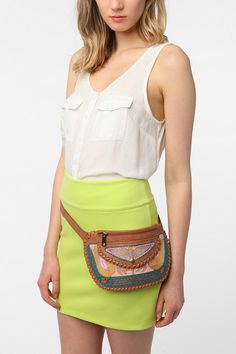 At the risk of being one of those fanny pack wearing people, I would still buy this. How convenient and cute is this thing?!  $39.00 @ urbanoutfitters.com