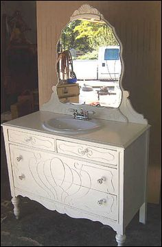 love the idea of turning a vintage dresser into a sink!