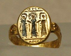 6th Century Wedding Ring with the Bride and Groom and God in the middle.