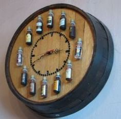 Whiskey Barrel Bourbon Clock - Kitchen/Bar crafting - Try Wine Bottles & barrel - It's like the upscale version of putting old bottles on top of your kitchen cabinets.