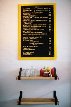 Candied Bakery, black & yellow menu board