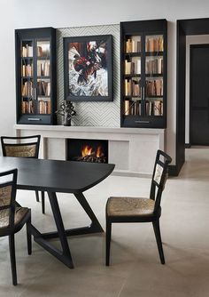 table chairs fire place