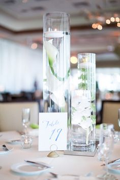 Submerged flower centerpieces with floating candles- simple and affordable